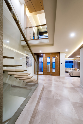 Luxury foyer with floating staircase